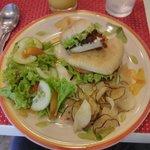 A mushroom vegan burger, camote chips, salad
