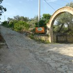 The entry, note the state of the road