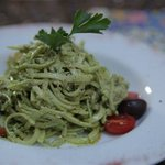 "Raw pasta , otherwise called ""zoodles"" with walnut pesto sauce"