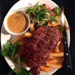 12oz Sirloin steak cooked on charcoal  BBQ. You must try.