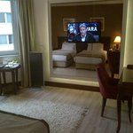 Flat screen in room and view of 2 beds