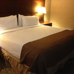 King bed. Modern headboard & linens