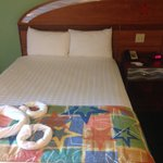 One of the double beds in our preferred room.
