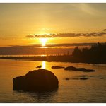 One of our guests from China captured this sunset this year.  Look at the seagull on the rock
