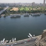 The boats on the Nile from the 25th floor. At night the boats are lit up with neon lights.