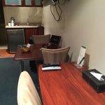 Desk and kitchenette.