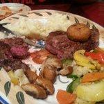 Tuscan ribeye with portobello mushroom caps the biggest and best steak I have had definitely the