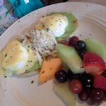 crab with eggs benedict on a bed of creamy avocado