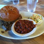 Pulled pork sandwich, coleslaw and beans
