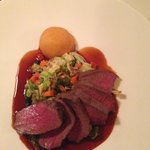 seared leg of deer, savoy cabbage, roasted almonds and sweet potatoes and balsamic