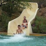 My husband and two boys enjoying the waterslide