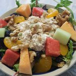 Chicken salad on a bed of greens w/fresh fruit