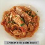 Mild red sauce, moderately breaded chicken over al dente pasta.