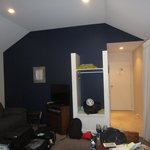 Minaret Room - Lounge/entry, the bathroom is behind blue wall (mess is our stuff - sorry!)