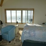 Bedroom in Suite with ocean view, balcony/deck to left