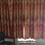Old musty 1970's looking curtains and AC unit Days Inn RM 221!