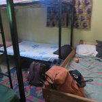 2 bunks and a twin stuffed into a tiny room leaving no space for a real exit.