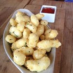Goat Cheese curds with chipotle ketchup.