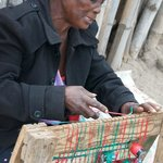 lady showing weaving techniques in the village