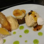Banana pudding w persimmon sorbet, pineapple crisp, sour cream icecream, liquorice and passionfr