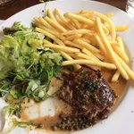 Minced beef steak and green peppercorn sauce with fries and green salad.