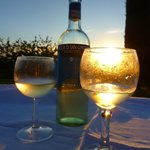 Wine and dine in the lovely garden with sunset view