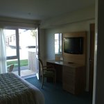 bedroom TV and dressing table with view of patio