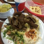 Gyro Platter, served with lentil soup,  drink, hummus, salad and pita. AMAZING!