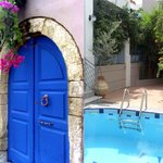The medieval entrance of Villa Athena Kallergi leads to the flower festooned courtyard and the p