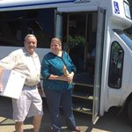 happy customers boarding Cheers bus with purchasesd
