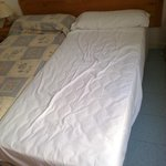 Mon lit pas refait après le massage de la femme de chambre