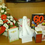 Complimentary flowers and clever towel swan