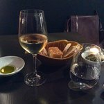 Waiting for food, with bread, oil and wine