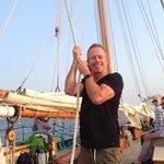 Here's my husband helping to hoist a sail!
