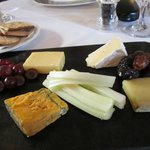 Artisan Cheese Slate with Biscuits, Celery and Macerated Fruits