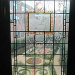 View of 18th century garden design through 17th century stained glass.
