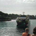 The boat arriving at Cala Gran