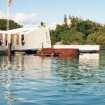 Close Up Of The USS Arizona Against The Memorial