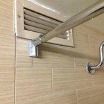 broken dusty vent in shower