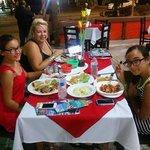 Friends enjoying dinner.