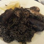 "Arroz negro ""rice with seafood with squid ink"""