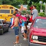 Street scene of the happy Tico soccer fans.