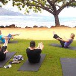 Pilates class on the beach at the St. Regis Princeville Resort