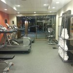 Two treadmills, elliptical, bike and yoga mats.