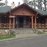 specialty cabin has four corner bedrooms with separate parlour and veranda access