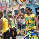 Olodum conductor doing a lap around the group, full of cheer.