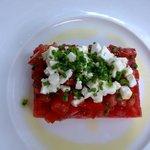 tomatoe, feta cheese, olive oil, herbs. so simple and so nice