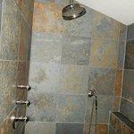 Rain shower good, hand held shower s/b fixed to wall