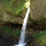 Upper ponytail falls notice cavern and people walking under the falls. About 0.7-0.9 miles from