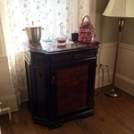 Windsow Suite mini fridge, complimentary night cap, and iHome set up
